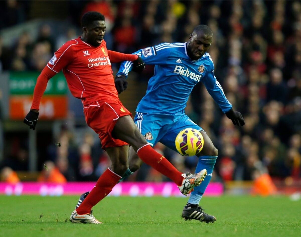 Sunderland's Jozi Altidore challenges Liverpool's Kolo Toure during their English Premier League soccer match at Anfield in Liverpool