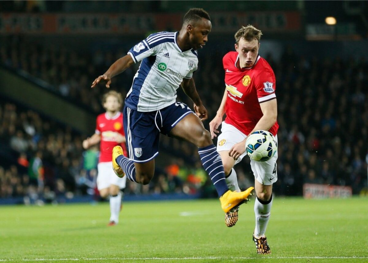 Saido Berahino of West Bromwich Albion and Phil Jones of Manchester United fight for the ball during their English Premier League soccer match at The Hawthorns in West Bromwich
