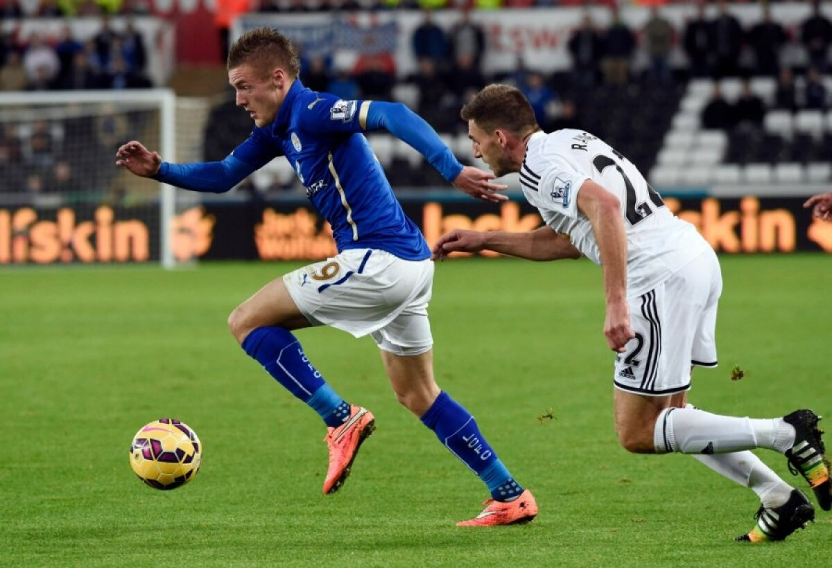 Swansea City's Angel Rangel chases Leicester City's Jamie Vardy during their English Premier League soccer match in Swansea