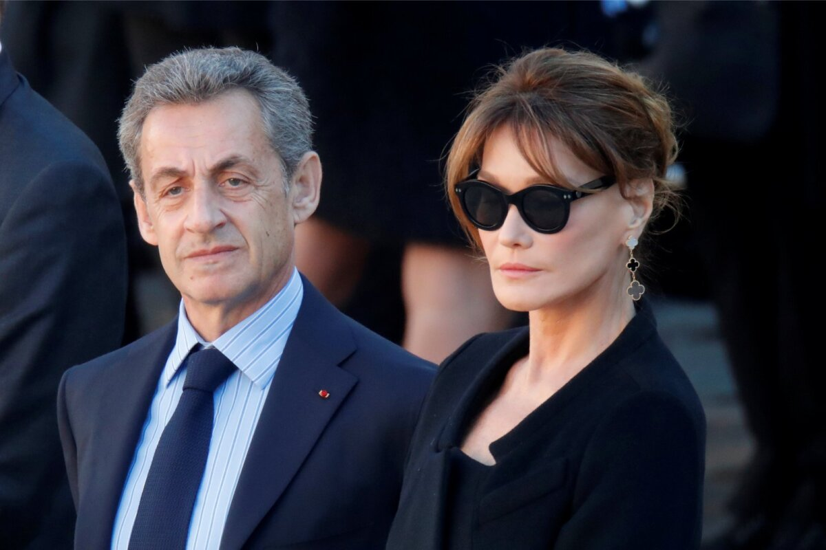Former French President Nicolas Sarkozy and his wife Carla Bruni-Sarkozy attend a national tribute for late singer Charles Aznavour during a ceremony at the Hotel des Invalides in Paris