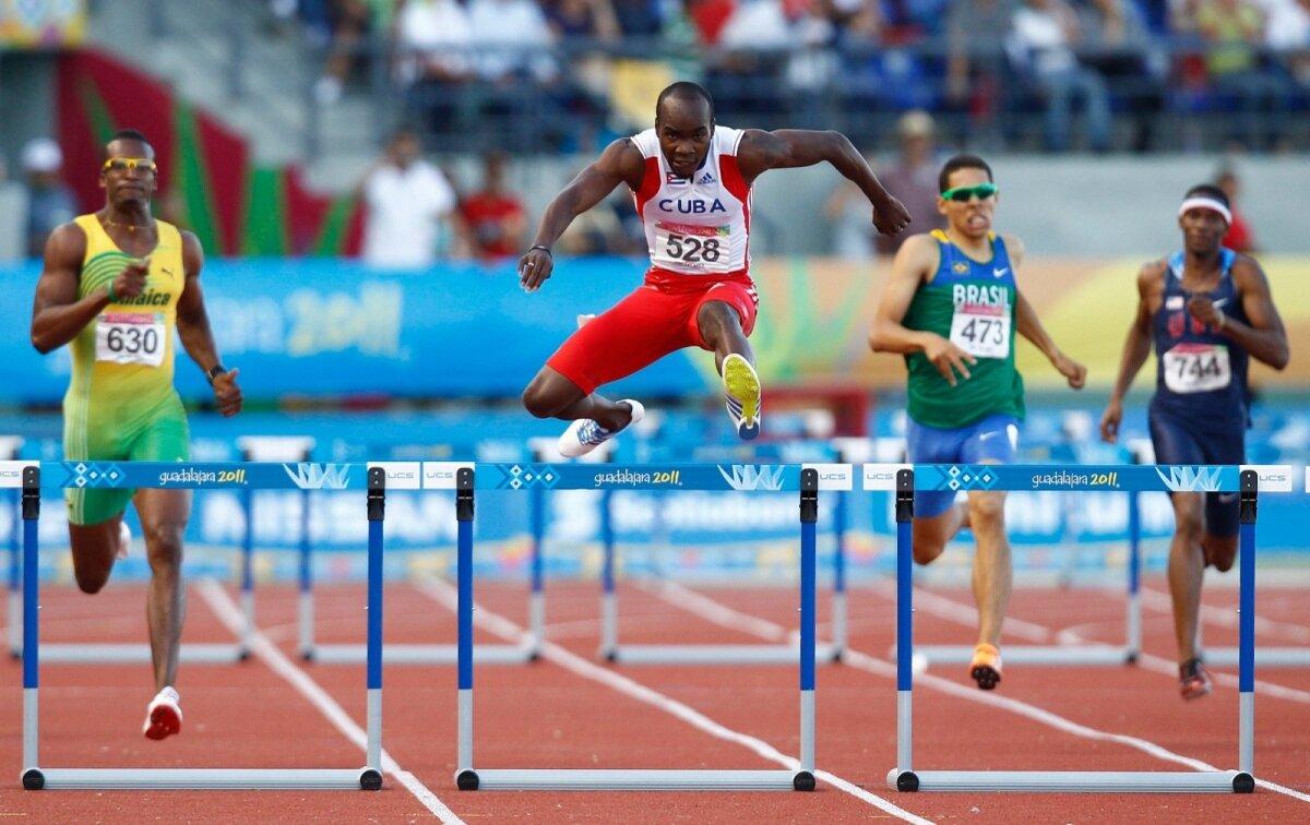 Cuba's Cisneros jumps the final hurdle in the men's 400m hurdles final at the Pan American Games in Guadalajara
