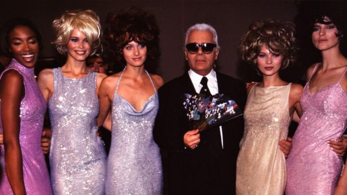 1996 год: Теннант (справа) с Карлом Лагерфельдом и моделями Наоми Кэмпбелл, Клаудией Шиффер и Кейт Мосс