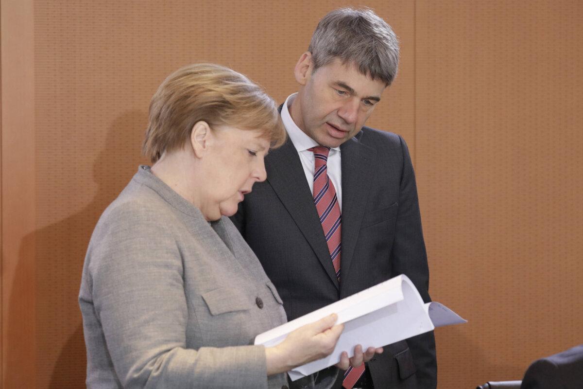 Jan Hecker ja liidukantsler Angela Merkel mullu jaanuaris.