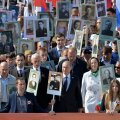 Russian President Putin holds the portrait of his father as he takes part in the Immortal Regiment march with pictures of World War Two soldiers on Red Square during the Victory Day celebrations in Moscow