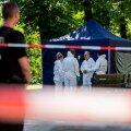Saksa kriminalistid 23. augustil mõrvapaigas