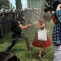 Turkish riot policeman uses tear gas against woman as people protest against destruction of trees in park in Istanbul