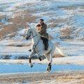 FOTOD | Kim Jong-un kappas valgel hobusel püha mäe tippu