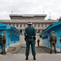 South Korean soldiers look towards the North Korean side on the border of the DMZ, in Panmunjom