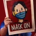 """Plakat Tokyo olümpial, mille sõnum on lihtne: """"Mask ette"""""""