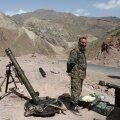Afganistani valitsusvägede sõdur teisipäeval Ghorbandis. Riik loodab USA vägede lahkumist korvata tsiviilisikute mobiliseerimisega.