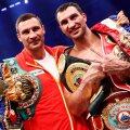 Klitschko of Ukraine celebrates with his brother after defeating Haye of Britain in a heavyweight title unification boxing match in Hamburg