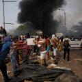 """Venezuela piirisillal pandi põlema kaks humanitaarabiveokit, opositsioonijuht palus maailmal kaaluda """"kõiki võimalusi"""""""