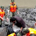 Rescue personnel work at landslide site that occurred in Xinmo Village