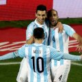 Argentina's Pastore celebrates his goal against Paraguay with Zabaleta and Messi during their Copa America 2015 semi-final soccer match at Estadio Municipal Alcaldesa Ester Roa Rebolledo in Concepcion