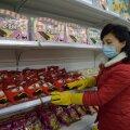 29. detsembril tehtud foto ametlikult tuurilt Pyongyangi kauplusse