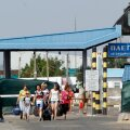 People cross over from Russia at the crossing point Pletenivka near the Ukraine-Russia border in the Kharkiv region