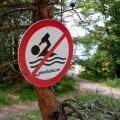 Hoiatusmärk ujumiskoha juures Andineemes