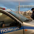 Russian police patrol in a car near accomodation and venues in the Olympic Park in Adler near Sochi
