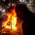 VIDEOD | Julgeolekuseadus tõi rahva taas Pariisi tänavatele, ent anarhistid kaaperdasid protesti ja alustasid märulit