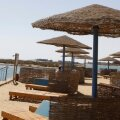 A tourist stands near an empty beach at the coast of the Red Sea of El-Gouna in Hurghada