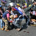 Anti-government protesters help a fellow protester injured in a grenade attack during a rally in Bangkok