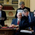 White House inner circle Priebus, Pence, Bannon, Spicer and Flynn attend as Trump speaks by phone with Putin in the Oval Office at the White House in Washington