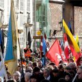 People hold flags as they participate in the annual procession commemorating the Latvian Waffen-SS (Schutzstaffel) unit, also known as the Legionnaires, in Riga