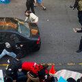 VIDEO | Seattle´is avas mees tema sõidukit peatada üritanud protestija pihta tule