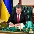 "Ukrainian President Petro Poroshenko signs the law on ""lustration"" in Kiev"