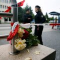 Flowers are placed near the Olympia shopping mall, where yesterday's shooting rampage started, in Munich