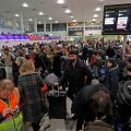 Passengers wait around in the South Terminal building at Gatwick Airport after drones flying illegally over the airfield forced the closure of the airport, in Gatwick