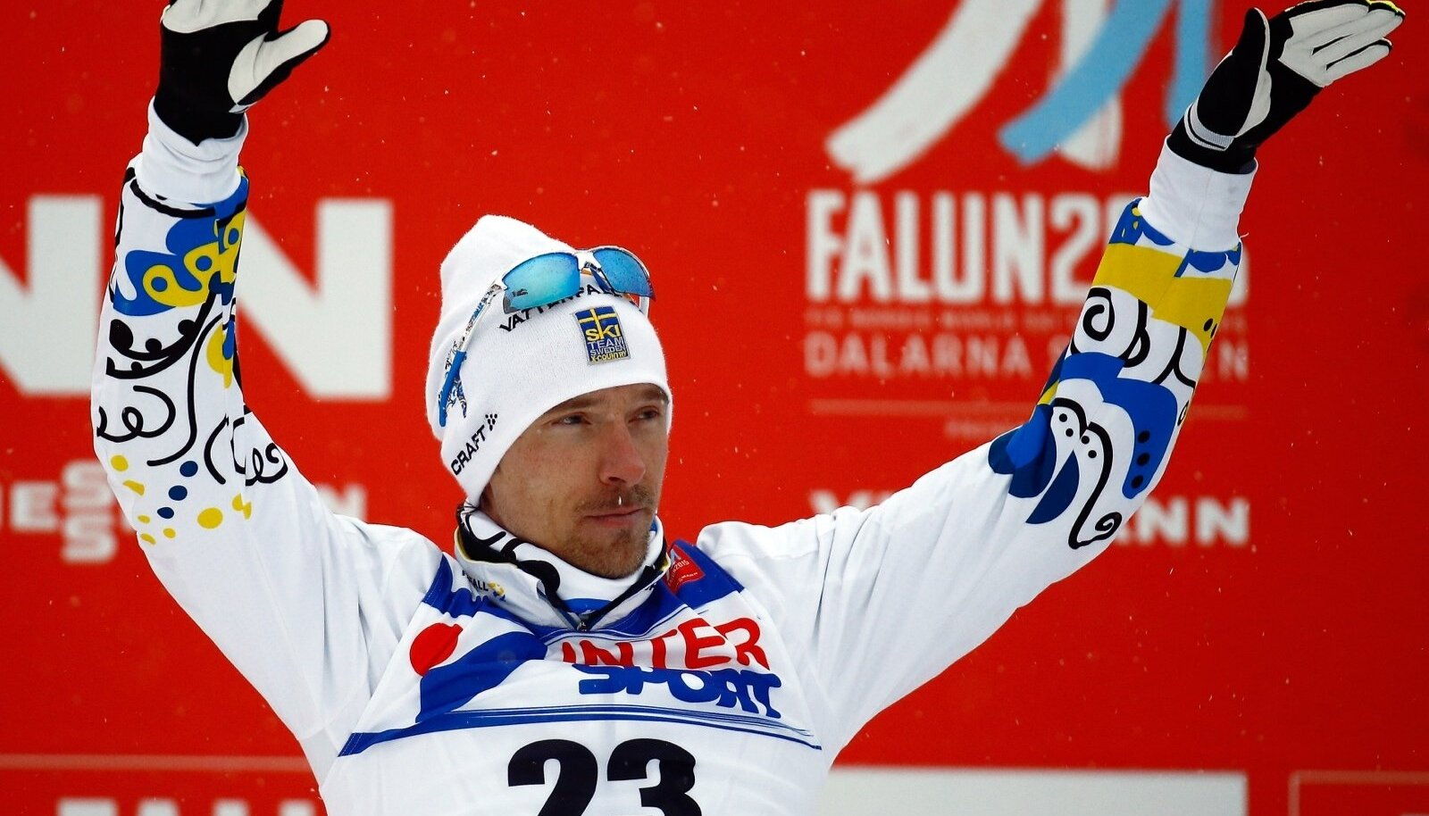 Sweden's Johan Olsson celebrates his third place in the men's cross country 50 km mass start classic race at the Nordic World Ski Championships in Falun