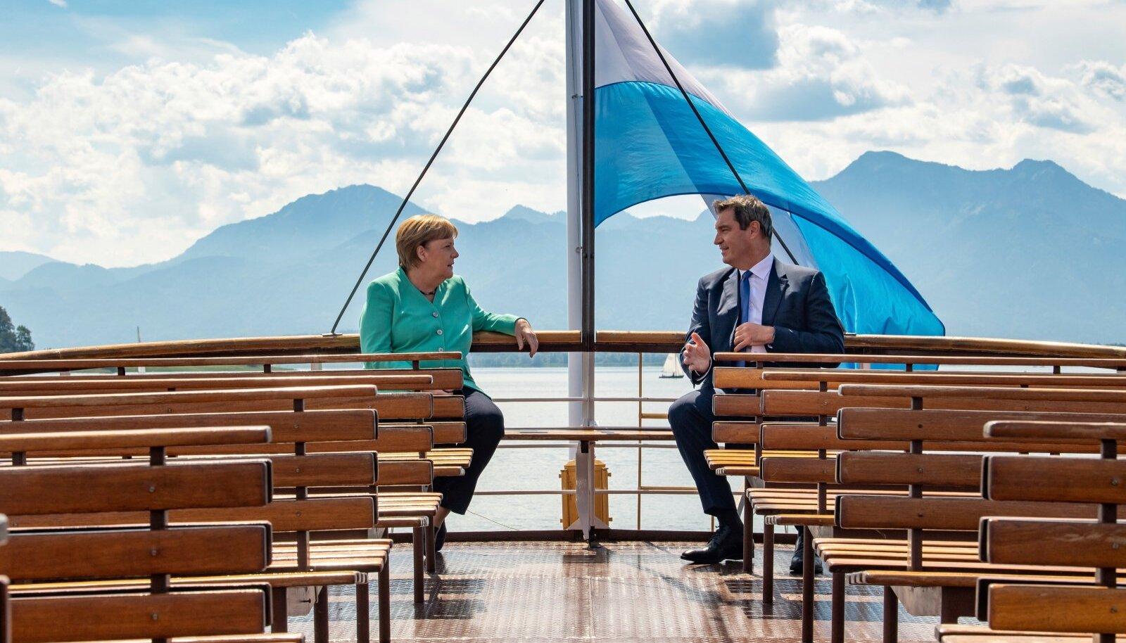 Kas praegune ja tulevane kantsler? Angela Merkel mullu suvel Baieri liidumaa peaministri Markus Söderiga tolle kodukandis paadisõidul