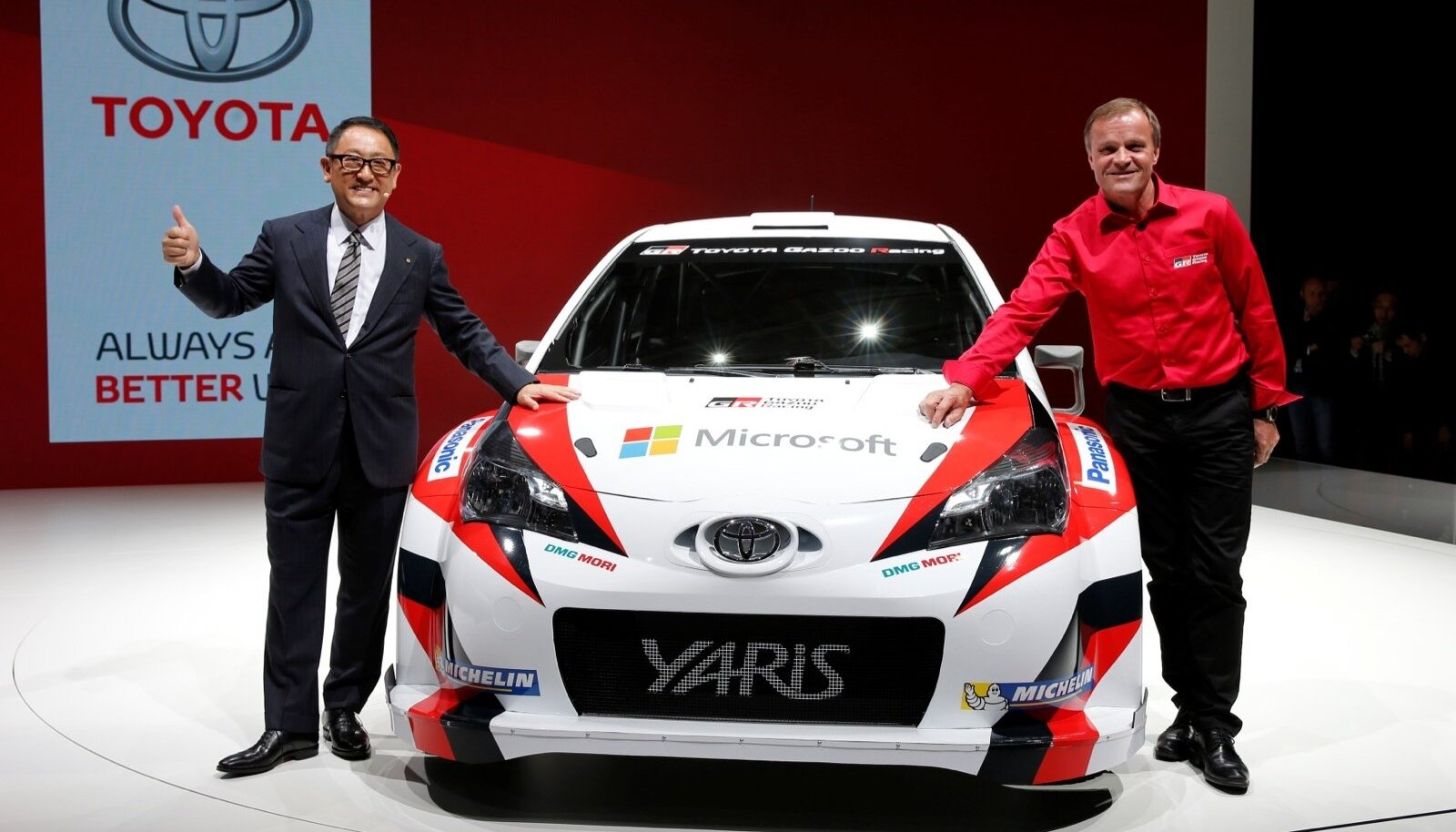 Akio Toyoda, President and CEO of Toyota Motor Corporation, and rally driver Tommi Makinen of Finland pose after a news conference on media day at the Paris auto show, in Paris
