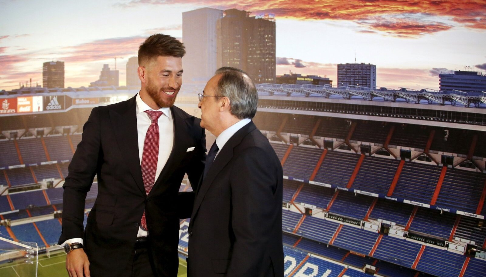 Real Madrid's Spain defender Sergio Ramos embraces Real Madrid president Florentino Perez at Santiago Bernabeu stadium in Madrid