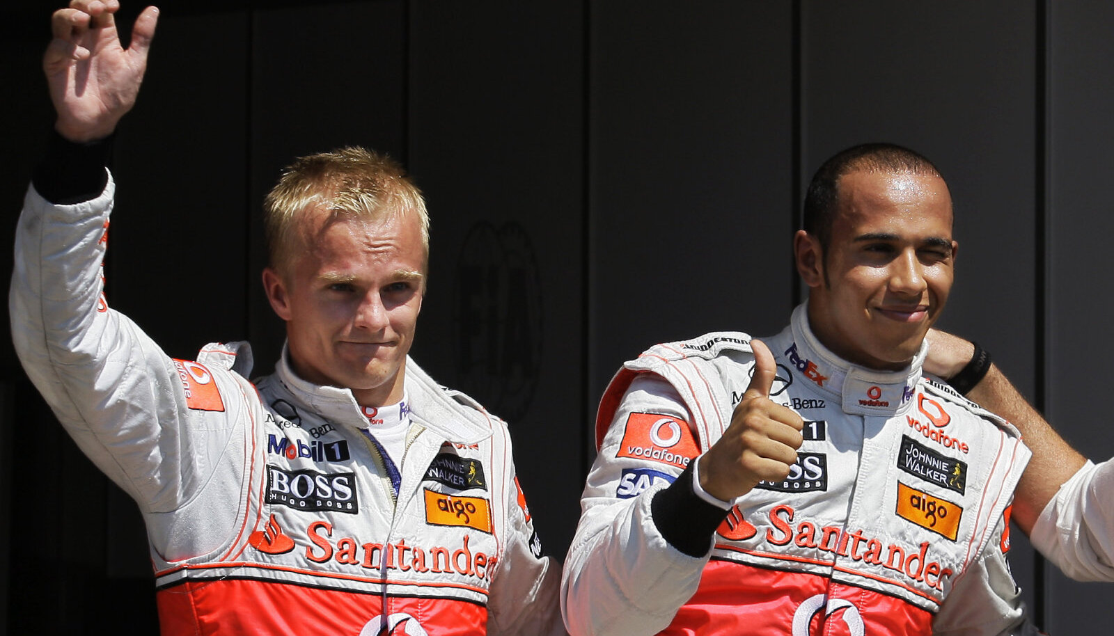Heikki Kovalainen ja Lewis Hamilton