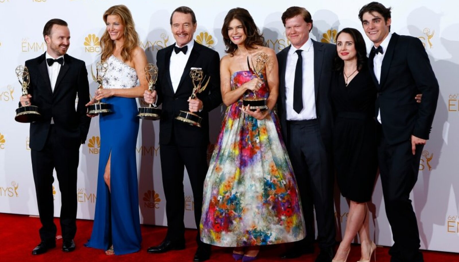 "The cast of ""Breaking Bad"" poses with their outstanding drama series award at the 66th Primetime Emmy Awards in Los Angeles"
