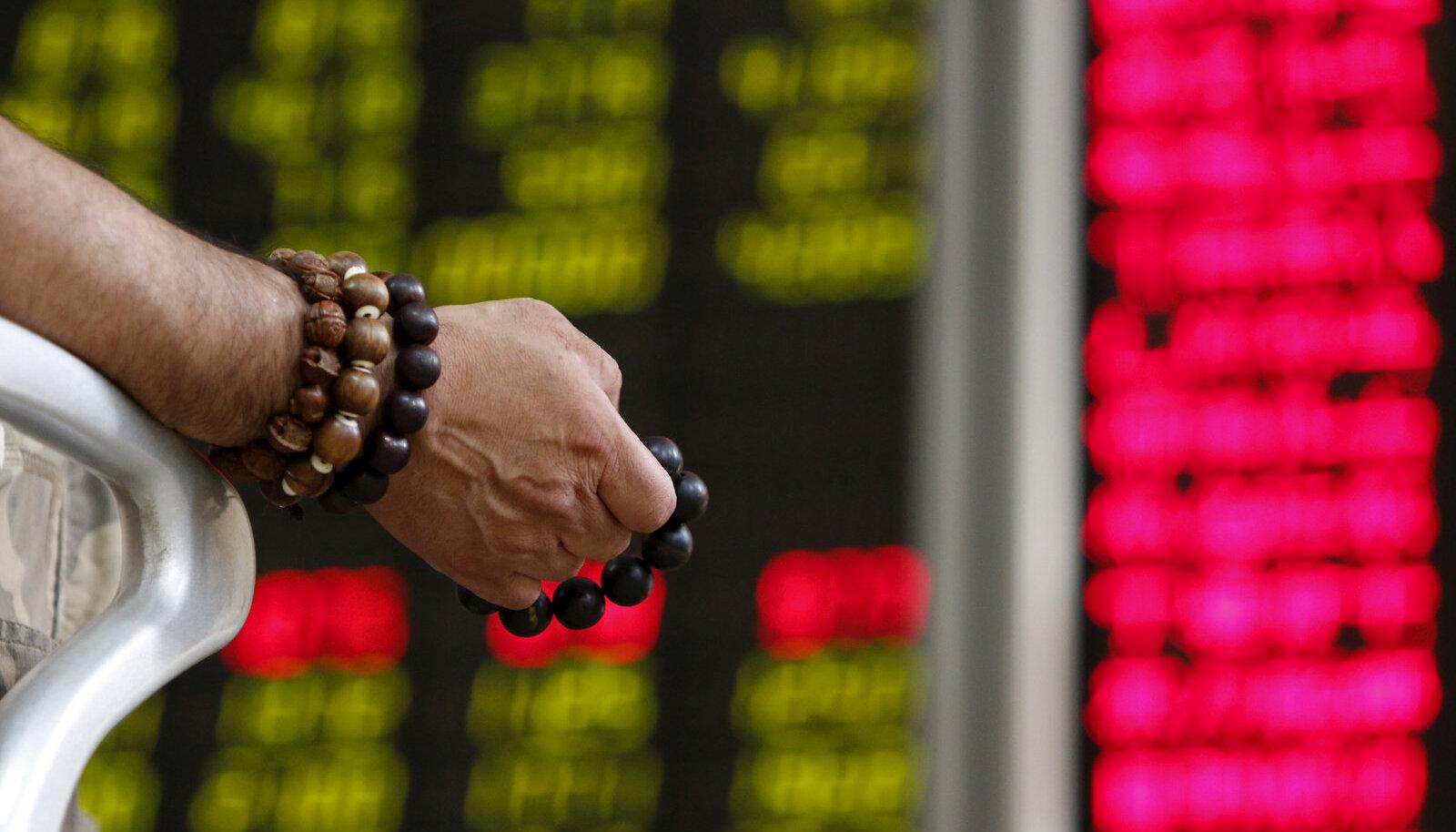 Börsilangus pani Pekingi maaklerfirmas investori palvet lugema