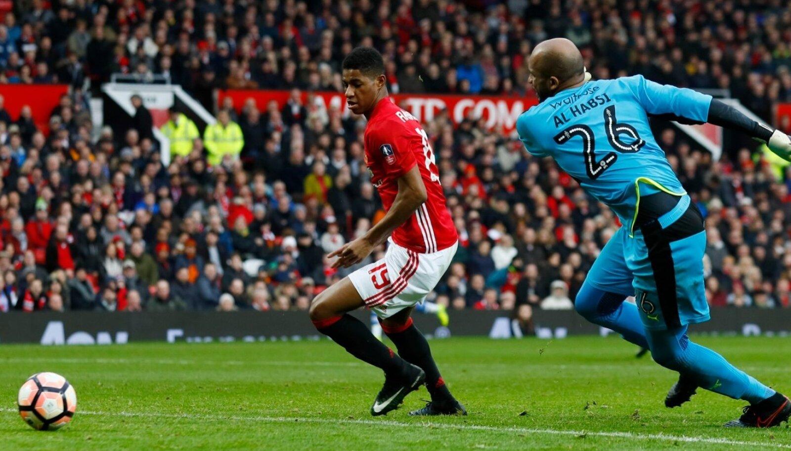 Manchester United's Marcus Rashford scores their fourth goal past Reading's Ali Al Habsi