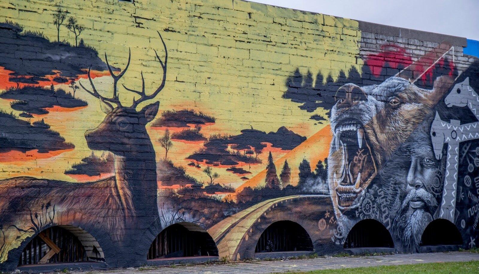 Linnahalli seintele maalitud kunst
