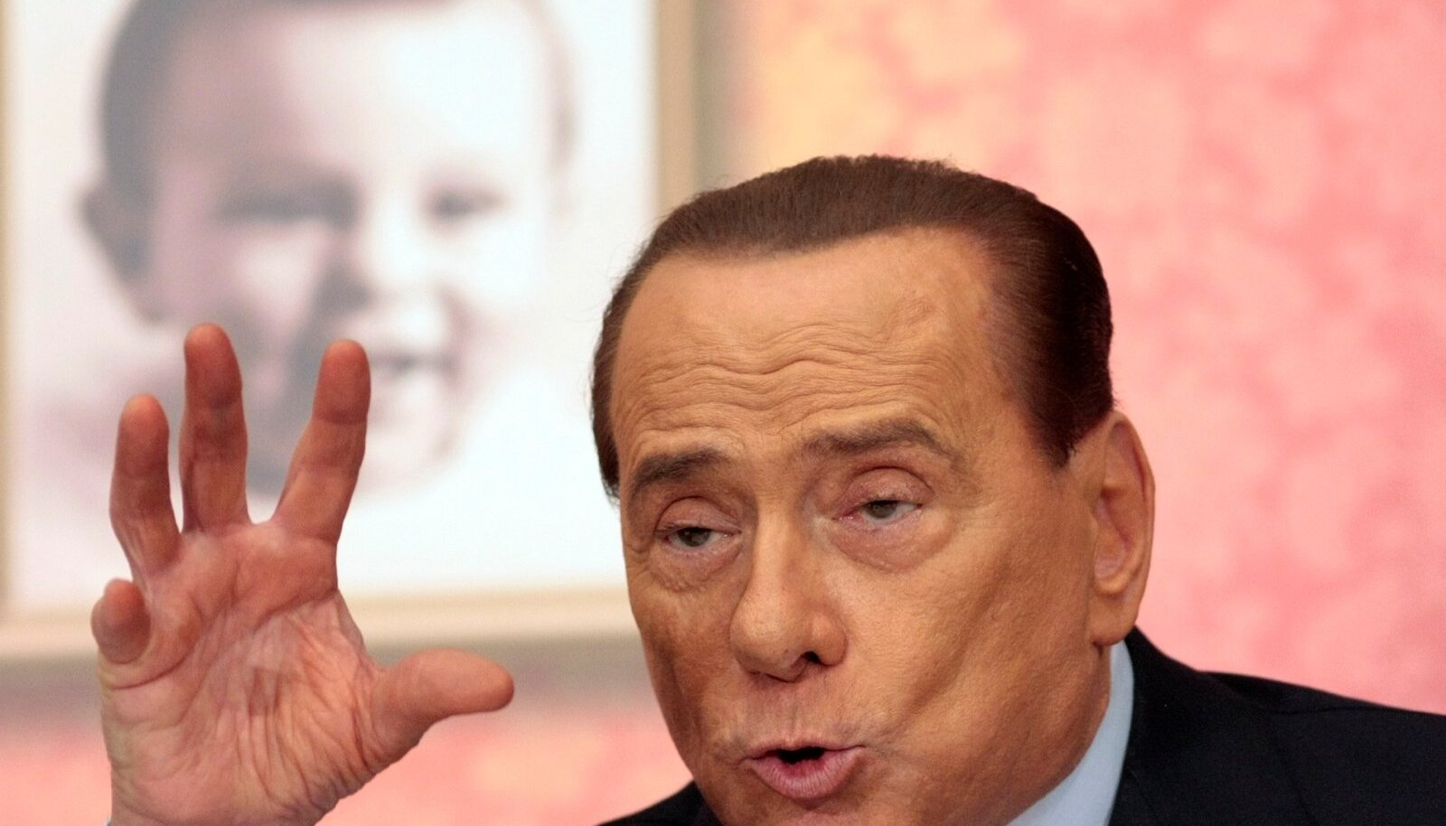 "Former Italian PM Berlusconi gestures as he attends the launch of a book ""Sale, zucchero e caffe'""by journalist Bruno Vespa, in downtown Rome"