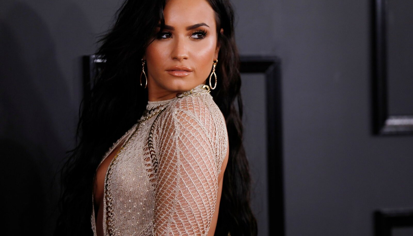 Singer Demi Lovato arrives at the 59th Annual Grammy Awards in Los Angeles