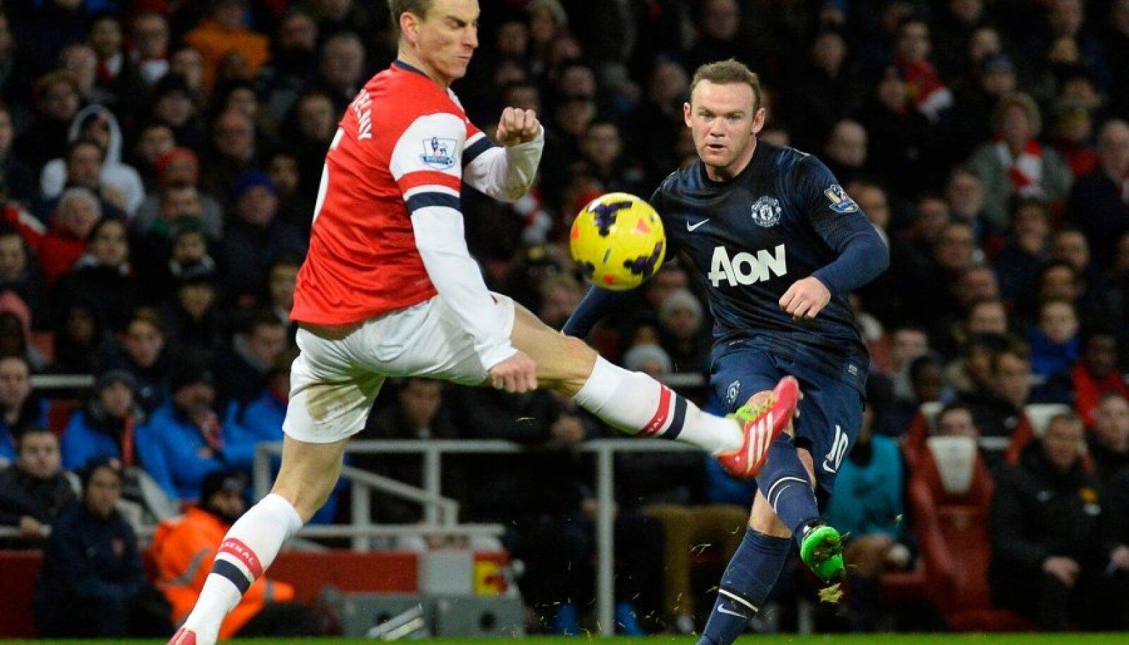 Wayne Rooney ja Laurent Koscielny