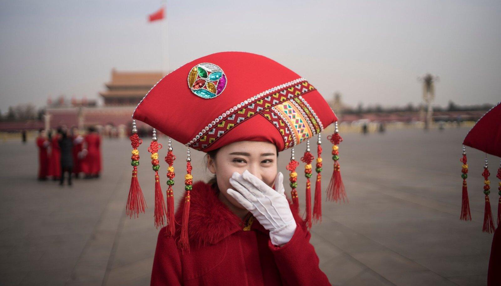 Saabujate tervitaja kommunistliku partei kongressil 2018. aastal Pekingis.