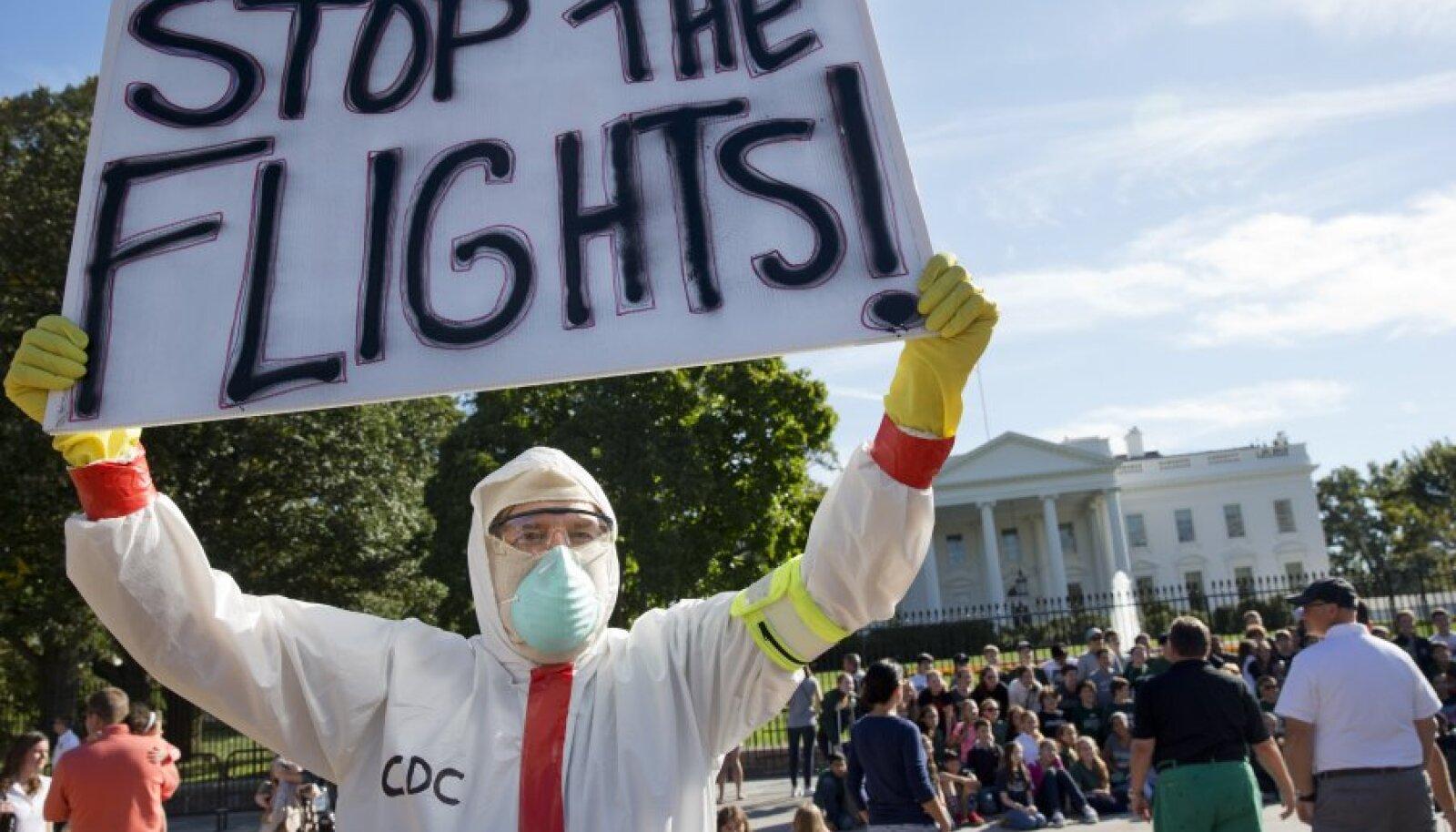Protestija Valge Maja ees nõuab lendude lõpetamist nakkusohtlikesse piirkondadesse.
