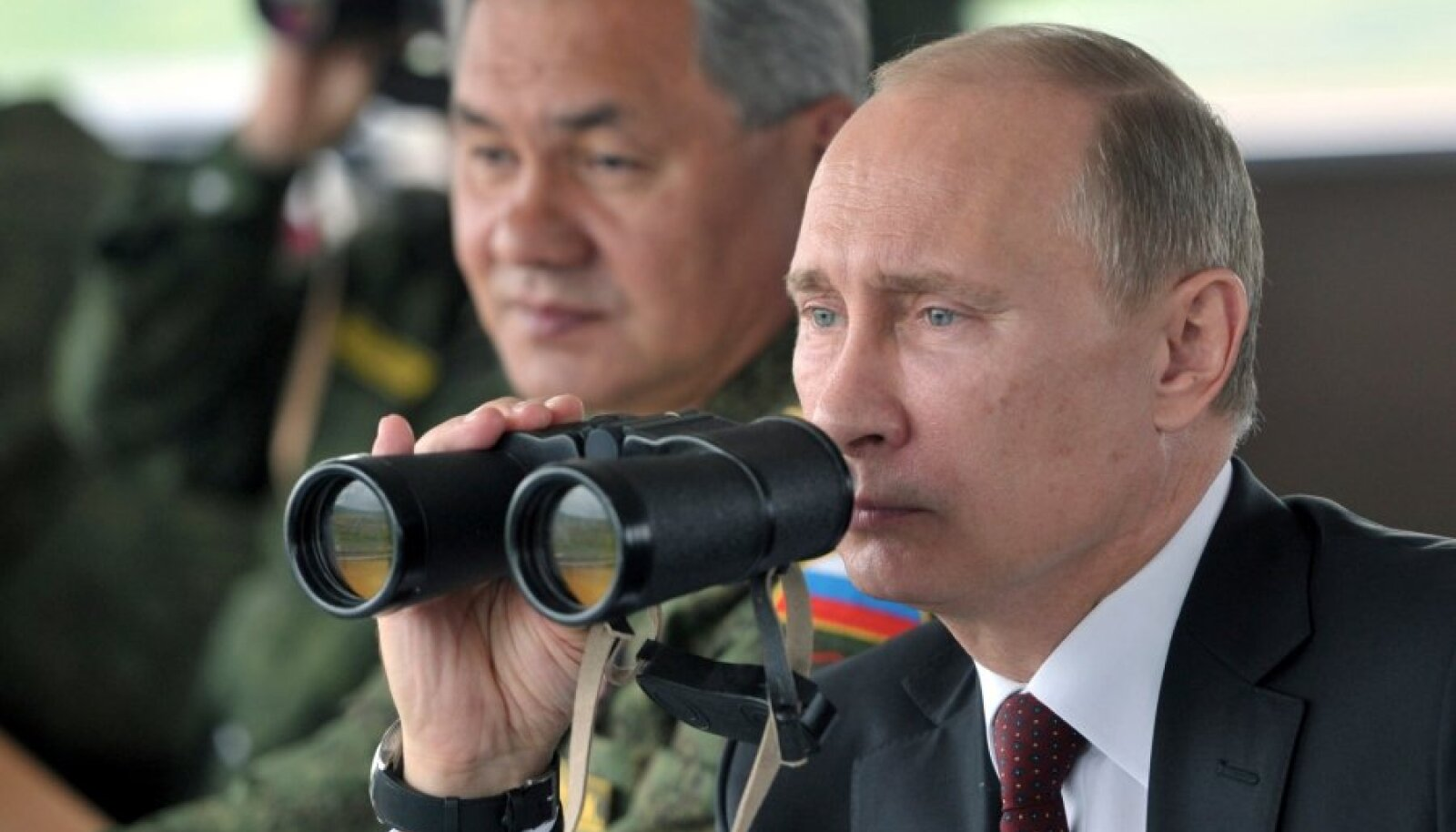 Russian President Putin watches military exercises with DM Shoigu during his visit to Russia's far eastern Sakhalin region
