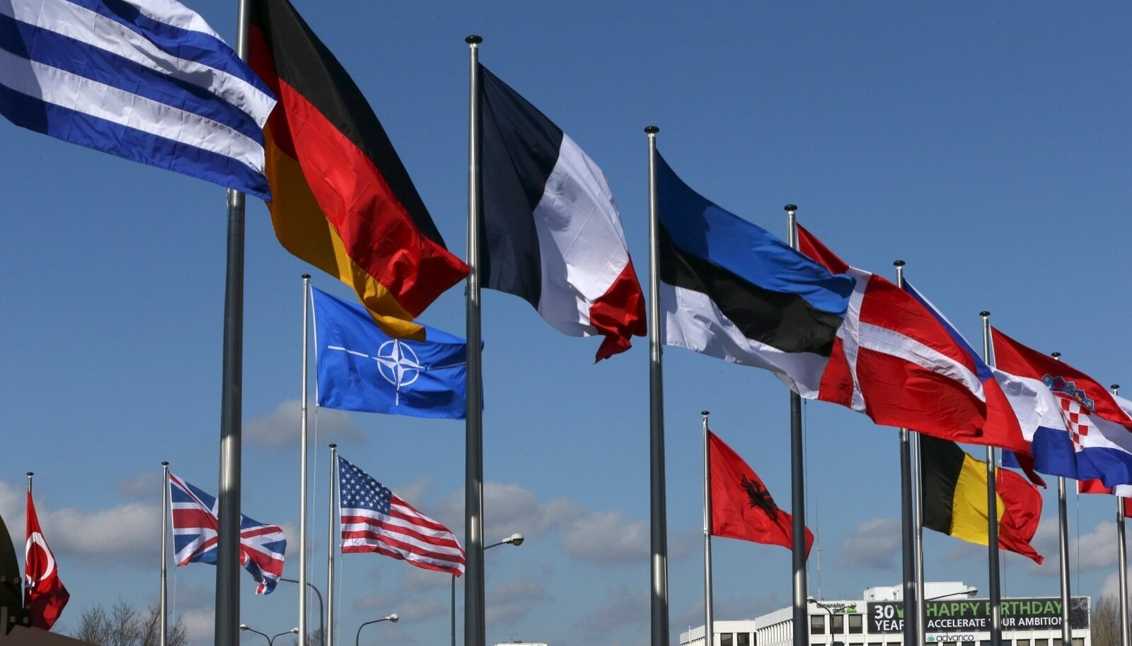 Flags fly at the Alliance headquarters in Brussels during a NATO ambassadors meeting on the situation in Ukraine and Crimea region