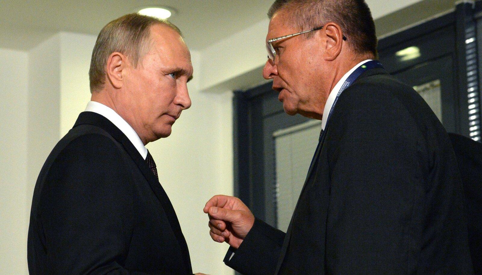 Venemaa president Vladimir Putin ja endine majandusarengu minister Aleksei Uljukajev