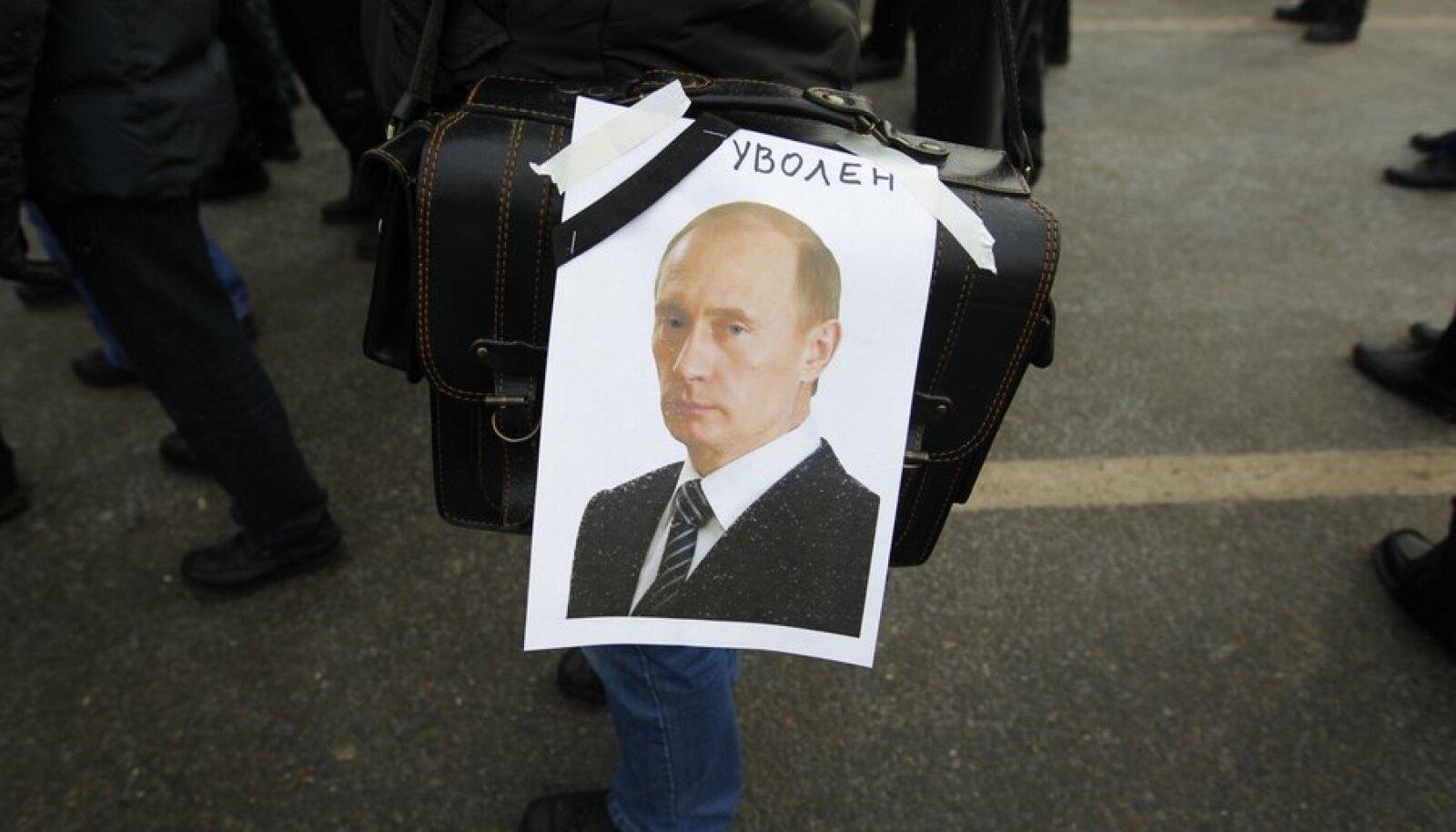 Vladimir Putin meeleavaldaja plakatil