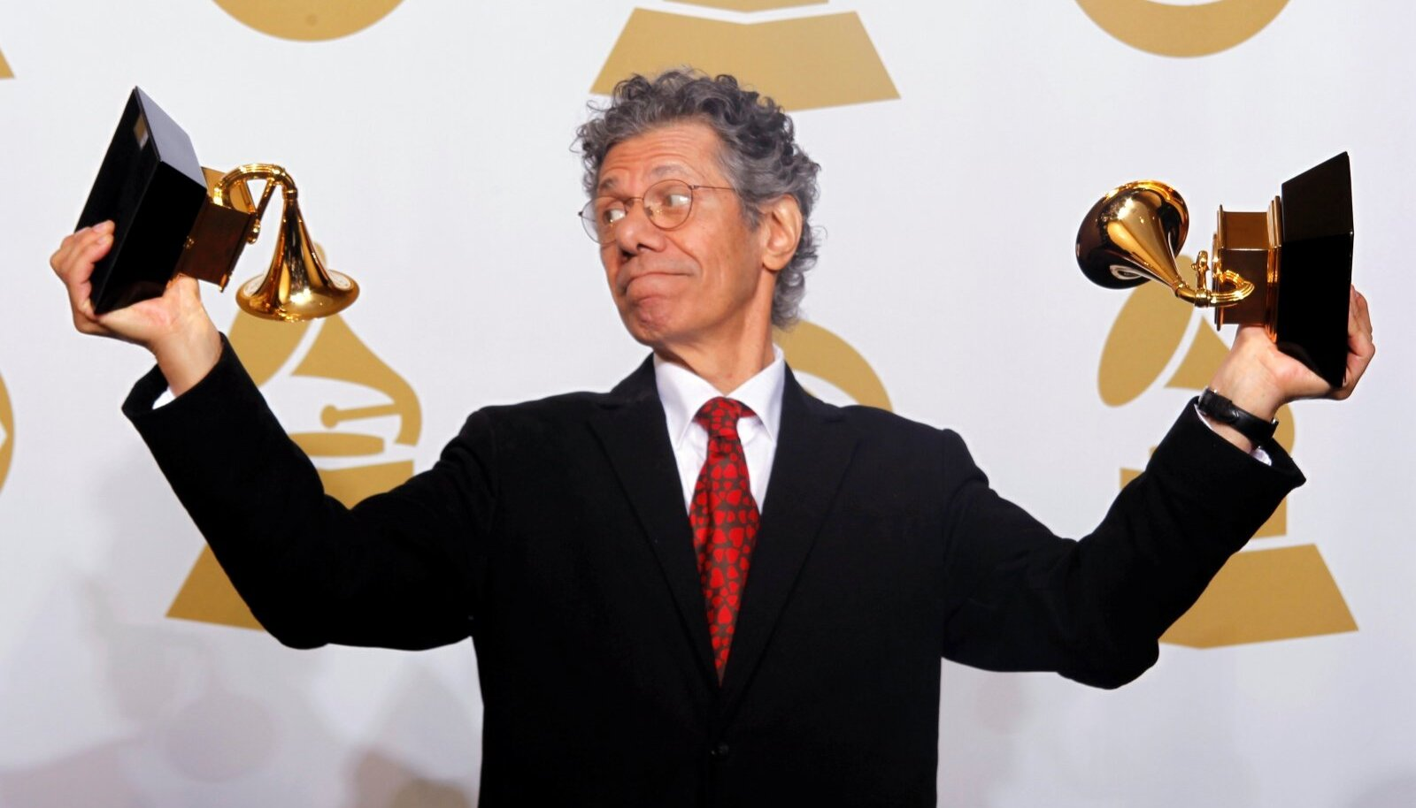 FILE PHOTO: Musician Chick Corea holds his awards for Best Improvised Jazz Solo and Best Jazz Instrumental Album in Los Angeles
